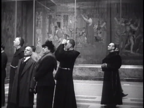 people priests standing in pinacoteca cu section of 'scuola di atene' teacher with students men before 'scuola di atene' painting - priest stock videos and b-roll footage