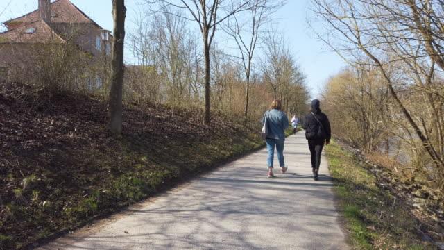 people promenading during coronavirus pandemic - march month stock videos & royalty-free footage