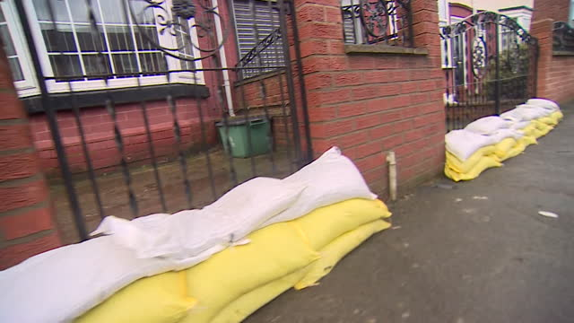 people protecting their homes from flooding, sandbags, and councils clearing drains, in doncaster, before the arrival of storm christoph - protection stock videos & royalty-free footage