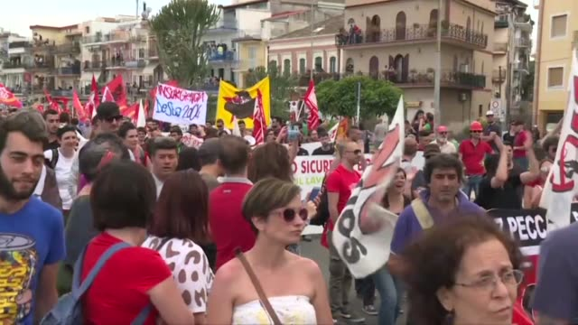 People protest against the G7 Summit in Giardini Naxos near the venue of the G7 summit in Taormina in Sicily