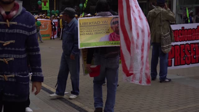 People protest in Bogota Colomboa on May 1 2018 during the International Labor Day