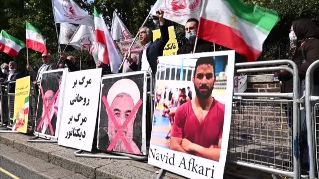 people protest in front of the iranian embassy in london after iran said it executed a wrestler for murdering a man during a wave of antigovernment... - execution stock videos & royalty-free footage