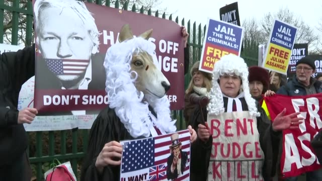 people protest outside the london court where the hearing to extradite whistleblower julian assange to the us is taking place - whistleblower human role stock videos & royalty-free footage