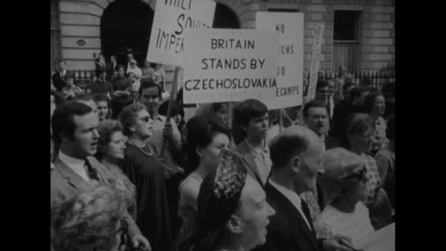 People protest outside the Polish embassy in London about the Russian led invasion of Czechoslovakia