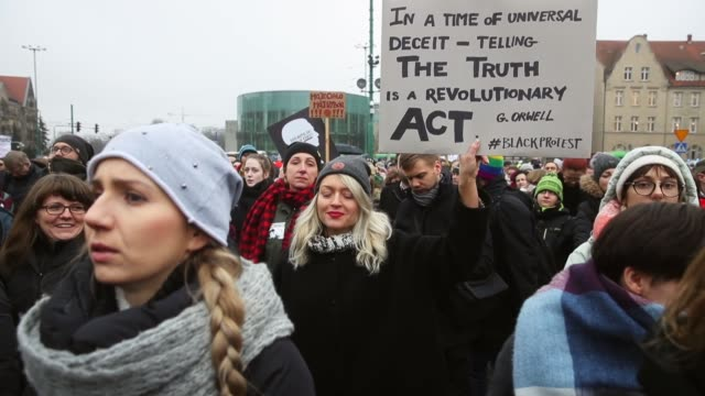 people protesting against a new government measure to further restrict abortions in poland march as part of 'black friday' demonstrations nationwide... - abtreibung stock-videos und b-roll-filmmaterial