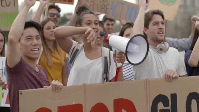 people protesting on street - western script stock videos & royalty-free footage