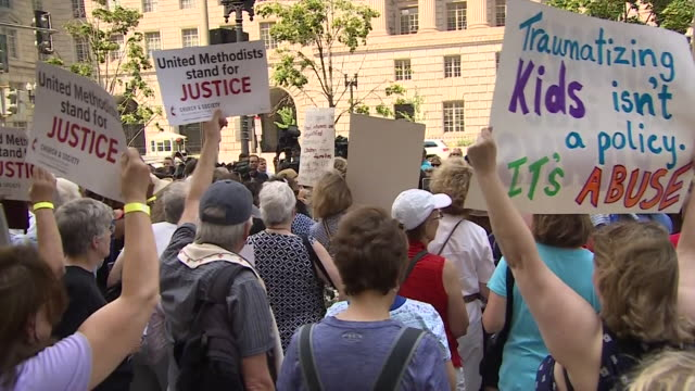 people protesting outside the border protection agency over migrant families being split up - separation stock videos and b-roll footage