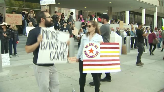 ktla people protesting trump travel ban outside federal building - federal building stock videos & royalty-free footage