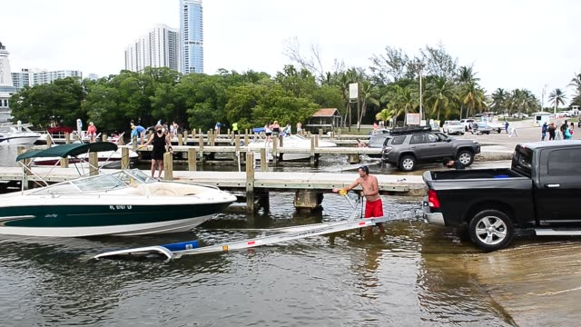 people pull out boats from the haulover marine center in miami, florida on memorial day weekend. boat ramps were closed for months amid the covid-19... - jet boating stock videos & royalty-free footage