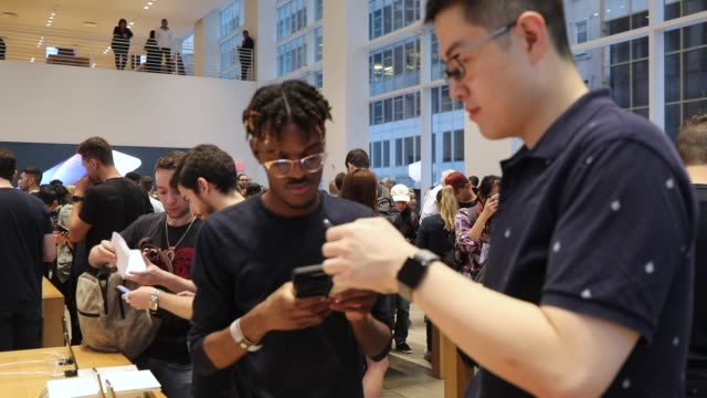 people purchase the new iphone xs and xs max at the apple store in midtown manhattan on september 21 2018 in new york city the two new phones which... - new stock videos and b-roll footage