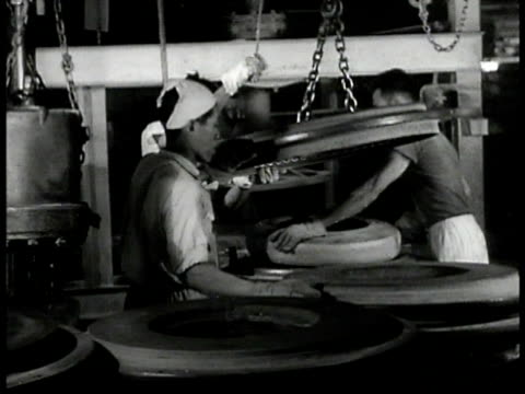 people pushing three large carts factory buildings bg worker pulling rubber tire out of mold w/ hook ropes indonesian workers making rubber tires... - rubber tree stock videos & royalty-free footage