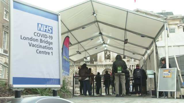 people queue at an nhs covid-19 vaccination centre in london, england for the pfizer-biontech covid-19 coronavirus vaccine in london on december 30,... - uk stock videos & royalty-free footage