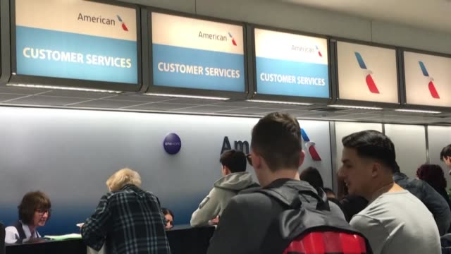 people queue at virgin and american airlines customer service desks at heathrow airport after us president donald trump announced a 30 day ban on... - forbidden stock videos & royalty-free footage