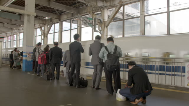people queue for and board a shinkansen train - railway station platform stock videos & royalty-free footage