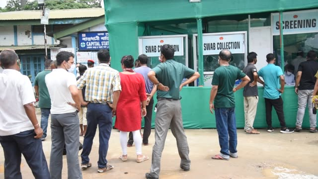 june 17: people queue for covid-19 swab test, during the ongoing nationwide lockdown on june 17 in guwahati, india. - epidemiologia video stock e b–roll