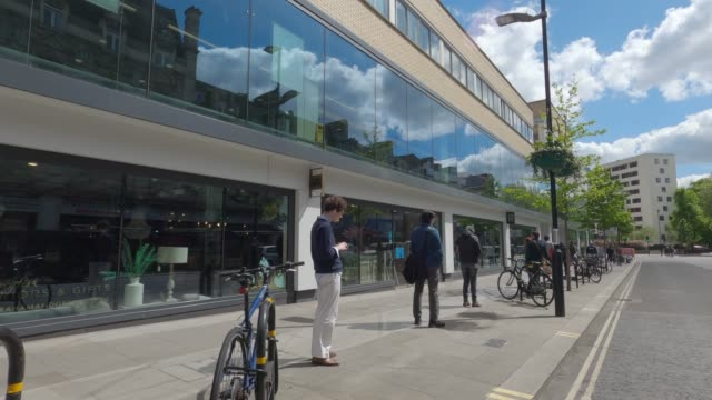 people queue outside a bayswater waitrose during the coronavirus pandemic on may 02 2020 in london england the uk remains in full lockdown due to the... - distant stock videos & royalty-free footage