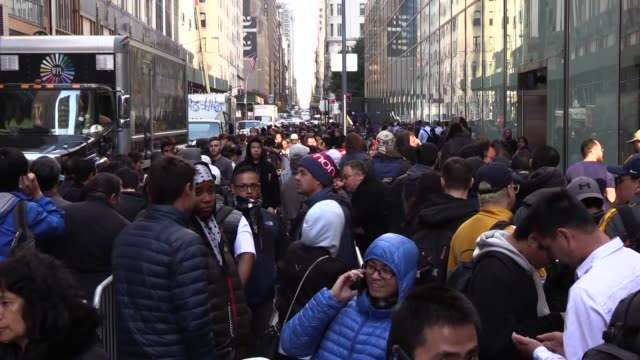 People queue outside an Apple store to buy the 10th anniversary iPhone X in New York on November 03 2017