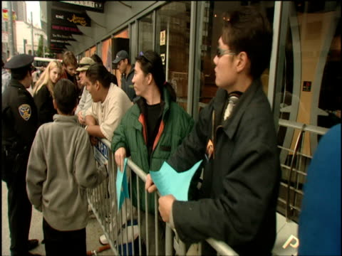 people queue outside store waiting to be first to buy new playstation 2 games console san francisco 22 nov 00 - sony stock videos & royalty-free footage