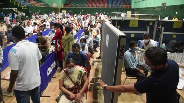 people queue to vaccinate against covid-19 in an indoor stadium on april 23, 2021 in guwahati, india. india reported 332,730 fresh coronavirus... - india stock videos & royalty-free footage