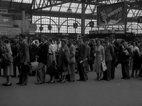 people queue up to purchase tickets from the booking office at waterloo station. - station stock videos & royalty-free footage