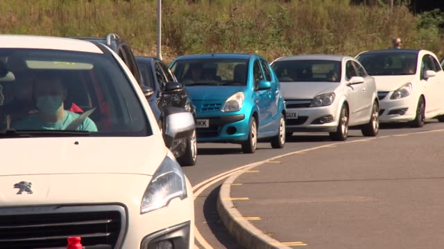 people queueing for coronavirus test at drive through testing centre in plymouth some people are experiencing problems with getting access to tests - problems stock videos & royalty-free footage