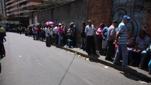 people queueing for food and other essentials in caracas venezuela - america del sud video stock e b–roll