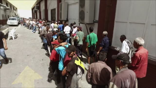 people queueing for food in caracas, venezuela - venezuela stock videos & royalty-free footage