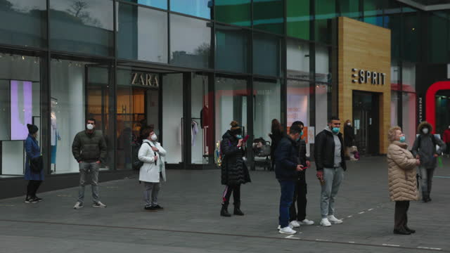 people queueing outside store as covid restrictions ease up in mainz, germany on wednesday, march 10, 2021. - decline stock videos & royalty-free footage