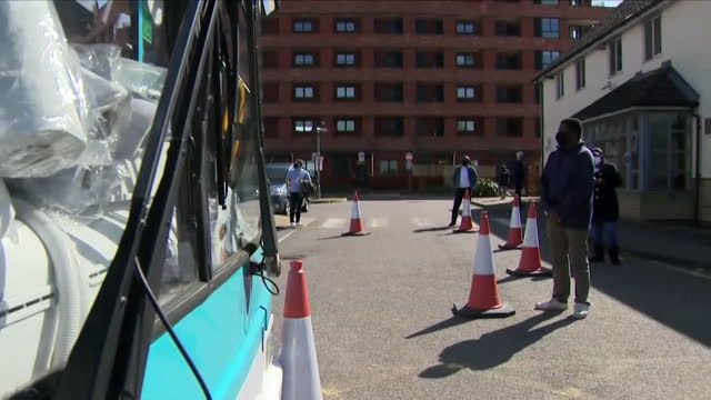 people queueing to receive the coronavirus vaccine - double decker bus stock videos & royalty-free footage