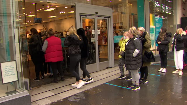 people queueing up outside primark in glasgow as retail shops reopen in scotland as coronavirus lockdown restrictions begin to ease - reduction stock videos & royalty-free footage