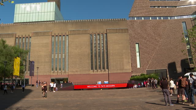 people queueing up outside tate modern art gallery, london, to get covid-19 vaccine, as it becomes a temporary vaccination centre - central london stock videos & royalty-free footage