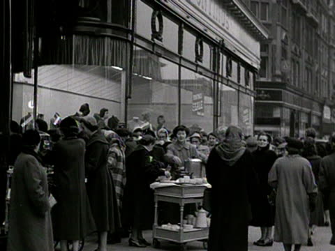 people queuing outside a department store for their winter sale are treated to a free cup of tea - department store stock videos & royalty-free footage