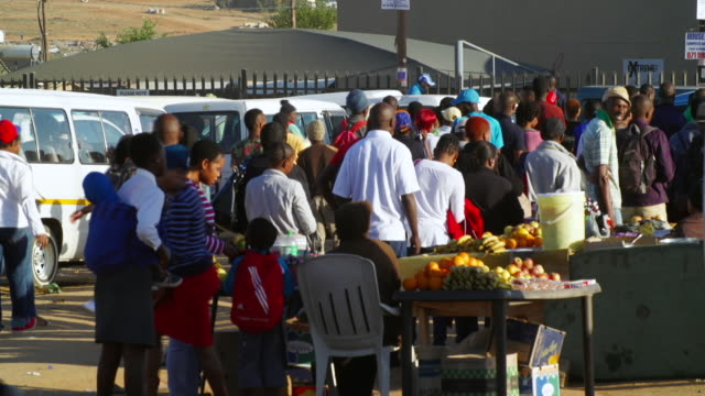 ws people queuing to board taxi and buying items from hawker / cosmo city, south africa - casual clothing stock videos & royalty-free footage