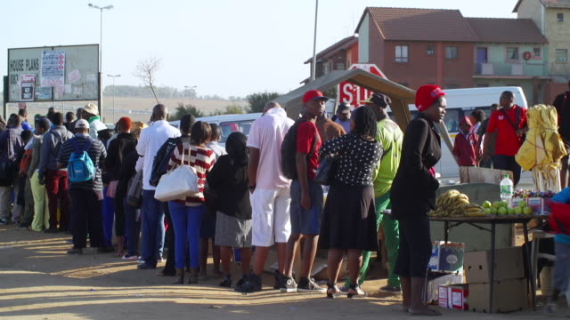 ws people queuing to board taxi and buying items from hawker / cosmo city, south africa - south africa stock videos & royalty-free footage