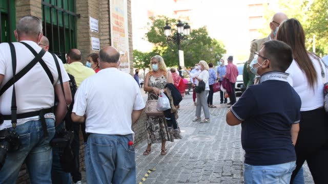 "people queuing to buy tickets for the bullfight at monumental de frascuelo bullring on september 26, 2020 in granada, spain. after the ""corpus"" fair... - ticket stock videos & royalty-free footage"