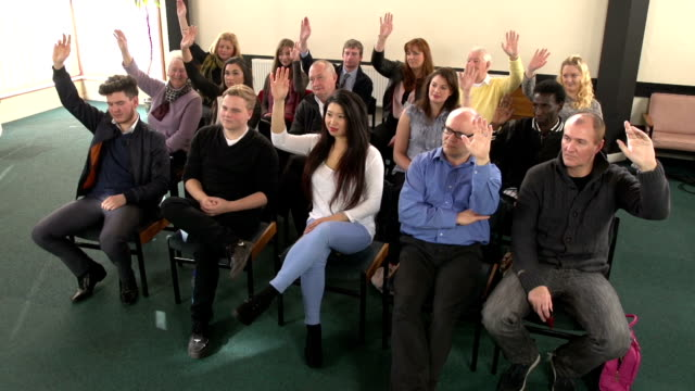 people raising hands in meeting - crane hd - question mark stock videos & royalty-free footage