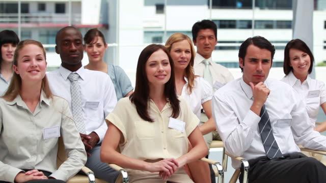 people raising their hands while sitting - hemd und krawatte stock-videos und b-roll-filmmaterial