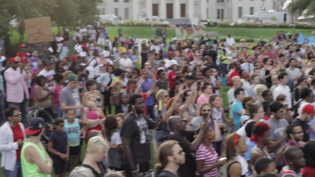 People rally in support of Michael Brown and other victims of police violence