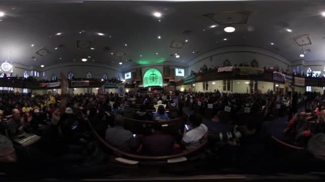 People rally together at the 'We're Here to Stay' immigration event at the Metropolitan AME Church on January 14 2017 in Washington DC The event is...