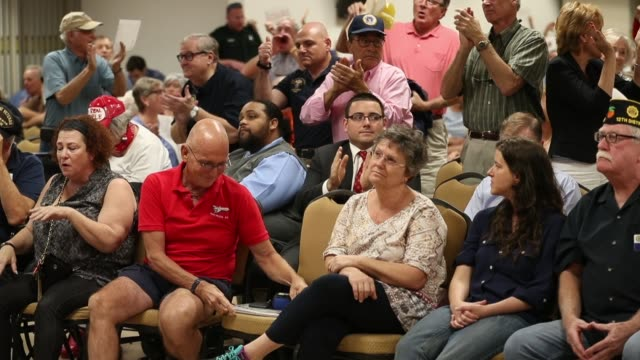 people react as they listen as rep. brian mast speaks during a town hall meeting at the havert l. fenn center on february 24, 2017 in fort pierce,... - town hall stock videos & royalty-free footage