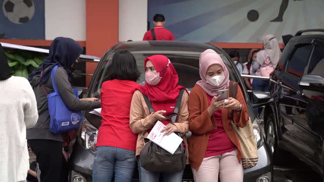 people receive a dose of the astrazeneca plc covid-19 vaccine during a vaccination drive hosed by indonesian retail merchants association in jakarta,... - human arm stock videos & royalty-free footage