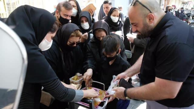 people receive donated traditional sweet as they attend a religious ceremony to commemorate tasoua a day ahead of ashura in southern tehran on august... - ashura muharram stock videos & royalty-free footage