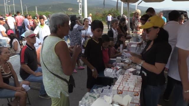 people receive medicines during a medical day organized by president nicolas maduro's government at tienditas international bridge in urena venezuela... - maduro stock videos & royalty-free footage