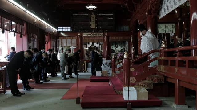 people receiving blessing from shinto priest on the first business day of the year at the kanda myojin shrine in tokyo, japan on monday, january 4,... - shinto shrine stock videos & royalty-free footage