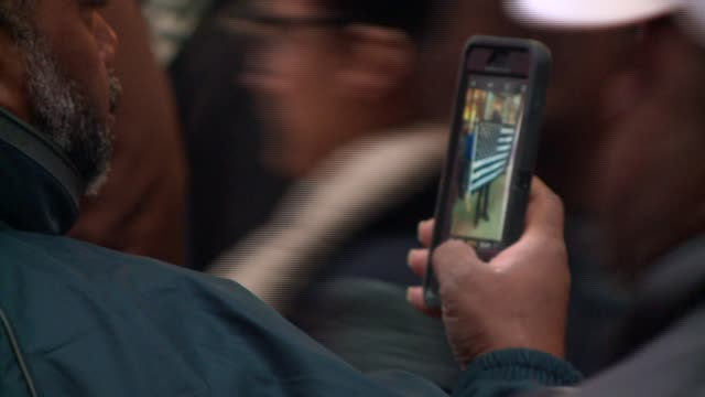 WGN People Record Protesters on Michigan Avenue on Black Friday With smart phones Protests erupted in the wake of the release of the video showing...