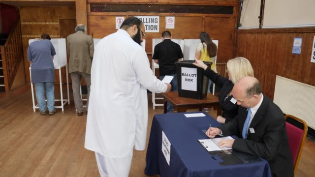 4k: people registering to vote at the election - voting at polling station - voting booth stock videos and b-roll footage