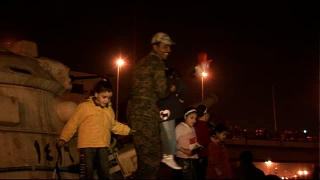 people rejoice as president hosni mubarak stands down egypt cairo soldier holding baby with egyptian flag children posing on tank with flag following... - president of egypt stock videos & royalty-free footage