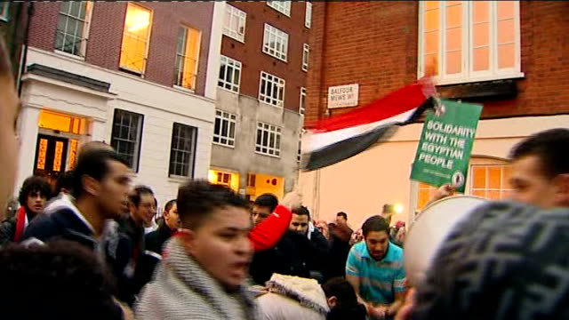 people rejoice as president hosni mubarak stands down england london ext people celebrating the downfall of egyptian president hosni mubarak outside... - president of egypt stock videos & royalty-free footage