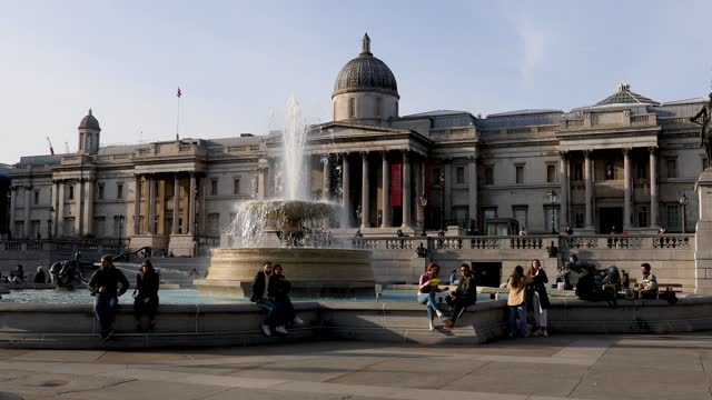 people relax and enjoy the sun in trafalgar square on march 09, 2021 in london, england. - fountain stock videos & royalty-free footage