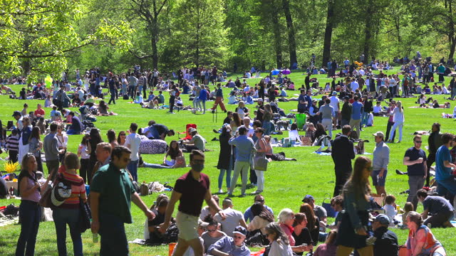 people relax and enjoy time with friends on the sheep meadow of central park in new york city, usa on may 1, 2021. visitor numbers at the park seem... - friendship stock videos & royalty-free footage